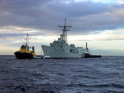 ex HMAS Canberra arrives in Port Phillip Bay on tow from Rockingham, WA to Geelong